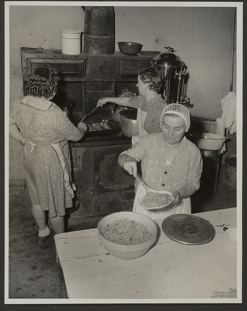 Cooking spaghetti and frying chicken for a spaghetti supper at Grape Festival, Tontitown, Arkansas