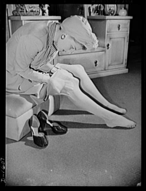 Cotton stockings. Ann Sheridan demonstrates the elasticity and sheerness of the new style of cotton hose