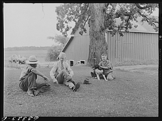 County supervisor talking with FSA (Farm Security Administration) tenant purchase borrower on front lawn of farm he has bought. Freeborn County, Minnesota