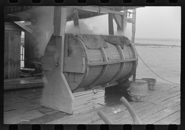 Crab cooker which holds about seven barrels of crabs. The cooking process lasts for thirty minutes and is done by live steam from boiler in background. Rock Point, Maryland