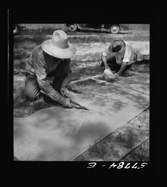 Cutting 16-mesh galvanized screen wire for door frame. Screening demonstration. Charles County, La Plata, Maryland