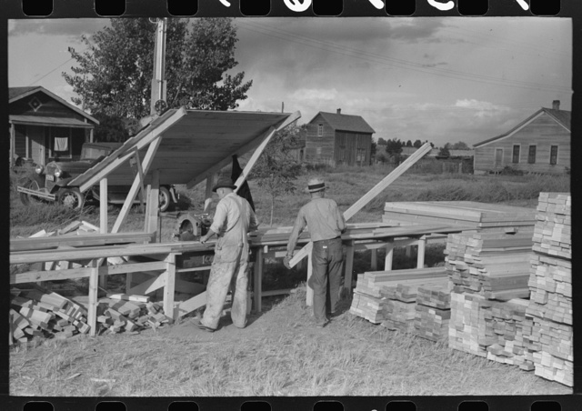 Cutting lumber to length for construction for sanitary units at FSA (Farm Security Administration) trailer camp. Stanfield, Oregon