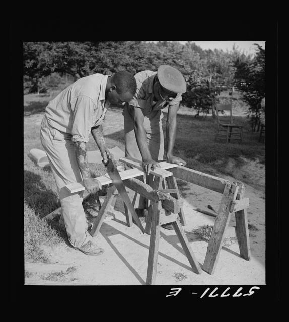 Cutting screen door stock to measurement. Screening demonstration. Saint Mary's County, Ridge, Maryland