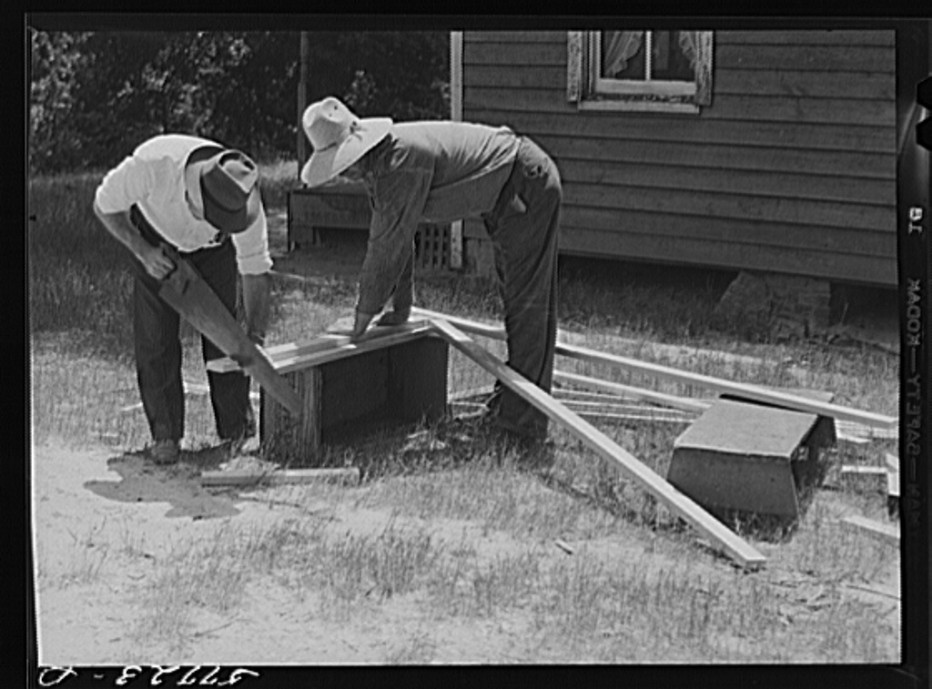 Cutting screen door stock to measurement. This material is known as 5/4 stock, three inches wide. Screening demonstration. Charles County, La Plata, Maryland