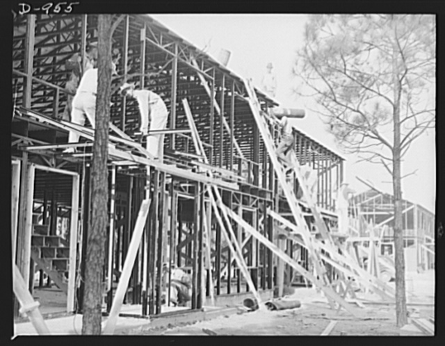 Defense housing. Ben Morrell Project, Norfolk, Virginia. Construction of the steel frame units. This project is being built by the Navy at a cost of $3,356,000 to house married enlisted personnel and civilians employed at the Norfolk naval base. Of the 1,362 units, 1,062 were completed by June 1, 1941 and the other 300 scheduled for completion August 15, 1941. Rents range from $17 to $23 a month
