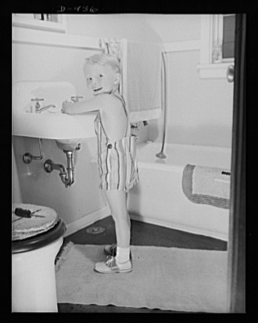 Defense housing, Erie, Pennsylvania. Bernie Rogan, son of Mr. and Mrs. B.J. Rogan, in the bathroom of the Rogan's new defense home at the Franklin Terrace housing project in Erie, Pennsylvania. His father is a drill press operator at the nearby plant of the General Electric Company, which is working three shifts on defense contracts