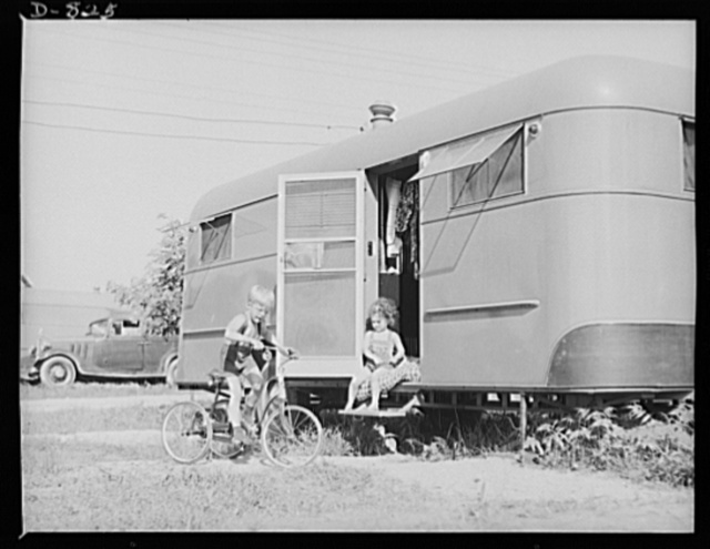 Defense housing, Erie, Pennsylvania. Each defense trailer is located on a plot of ground 25 x 50 feet, assuring a fine degree of privacy and room for children to play. Standards set up by the Office of Emergency Management (OEM) Division of Defense Housing for trailers provide a minimum overall length and width to assure the least possible crowding. The trailers are protected from fire and the city's fire bureau regularly conducts inspections. Manager Ackerman and the Lawrence Park Commissioners see to it that the trailer camp is well policed