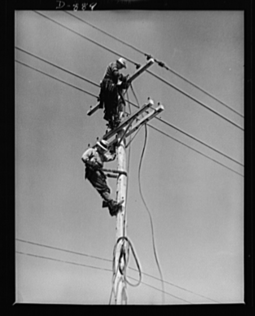 Defense housing, Erie, Pennsylvania. Electricians wiring defense homes at Franklin Terrace housing project. Defense homes are provided with electricity, sewage, police and fire protection. In many cases, a lump sum for all services is paid to the city in lieu of taxes
