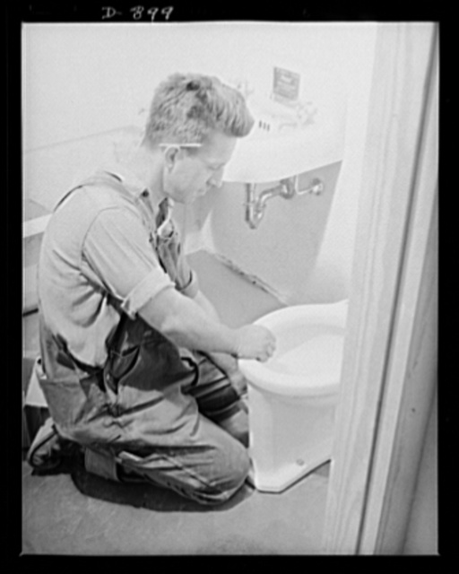 Defense housing, Erie, Pennsylvania. Modern bathrooms are speedily installed in the 300 defense homes at the Franklin Terrace housing project