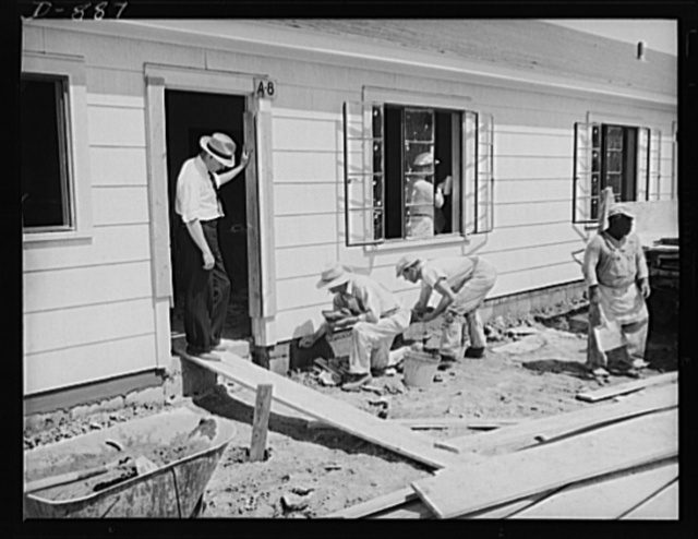 Defense housing, Erie, Pennsylvania. Richard S. Neff (standing in doorway) U.S. Housing Authority Inspector, who with his crew of five men, sees that defense homes meet up with the standards established by the Office of Emergency Management (OEM) Division of Defense Housing Co-ordination