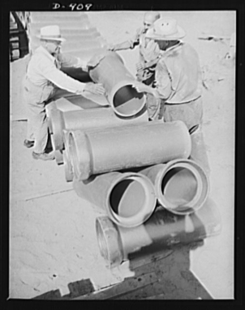 Defense housing, Erie, Pennsylvania. Sewage pipes are placed for the 300 defense homes at the Franklin Terrace housing project. Sewage, water, police and fire protection are provided by the city for a lump sum paid in lieu of taxes