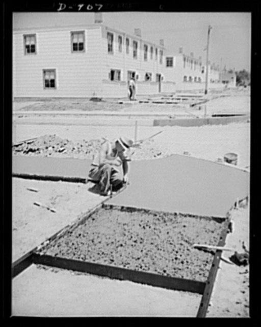 Defense housing, Erie, Pennsylvania. Sidewalks are paved and smoothed while the 300 defense homes at the Franklin Terrace housing projects are rapidly nearing completion