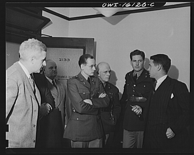 Detroit, Michigan. Conference between U.S. Army ordnance and washing machine industry official to determine the ability of manufacturers to produce parts needed by the Army. After inspecting samples, blueprints and prices were discussed