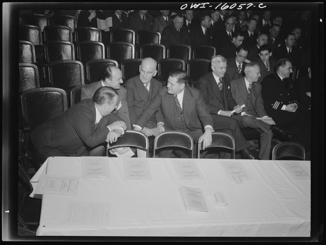 Detroit, Michigan. Kanzler and MacCauley, of the Packard Motor Car Company; Keller of the Chrysler Corporation; Wilson of the General Motors Corporation at an early meeting of the Automobile Council for War Production