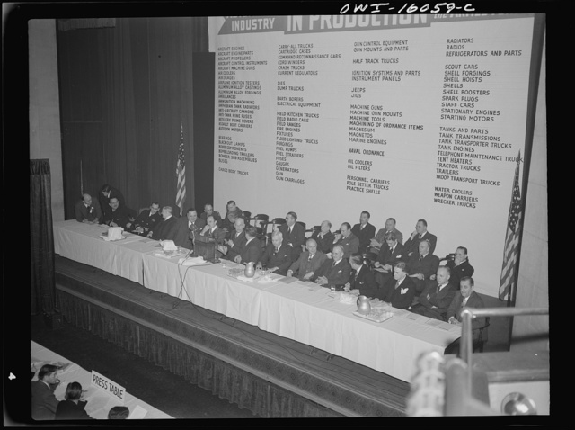 Detroit, Michigan. Speakers' platform in front of a list of products manufactured by the automobile industry. Ernest Kanzler speaking at an early meeting of the Automobile Council for War Production