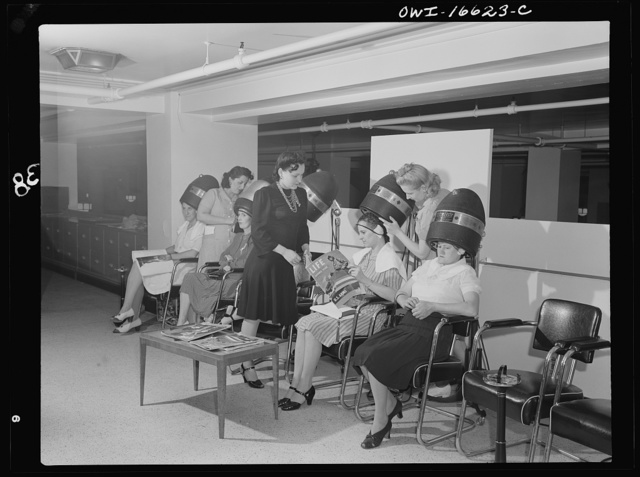 Detroit, Michigan. Women drying their hair in the beauty shop at the Crowley-Milner department store