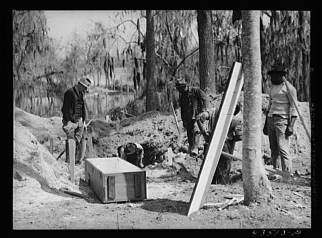 Digging out a cemetery to be moved from the Santee-Cooper basin. Near Bonneau, South Carolina