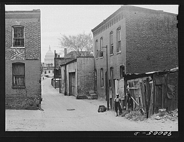 Dingman Place, N.E. with Capitol dome in background. Negro tenements; four small rooms rent for fifteen dollars per month. Water and privy in yard