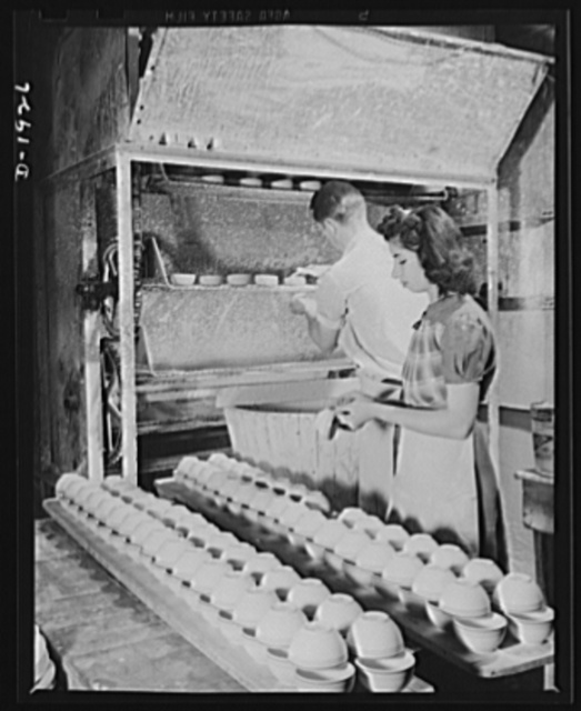 Dipping cups in glaze solution and drying. Shenango Pottery Works, Newcastle, Pennsylvania