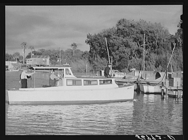 Docking boat at Sarasota trailer park pier. Sarasota, Florida