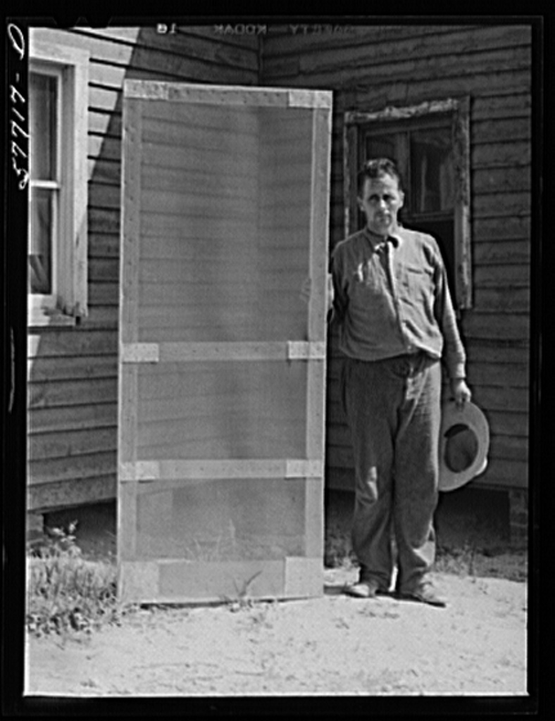 Door frame with screen wire assembled ready to fasten on hinge strip.  Screening demonstration. Charles County, La Plata, Maryland
