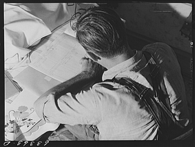 Douglas County, Wisconsin. FSA (Farm Security Administration) borrower working over his account book. Sixteen families from the Nebraska drought area have moved to this part of Wisconsin during the past few years; most of them received FSA loans