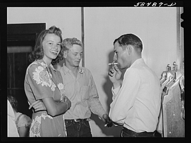 Dude girl with two cowboys at a Saturday night dance in Birney, Montana