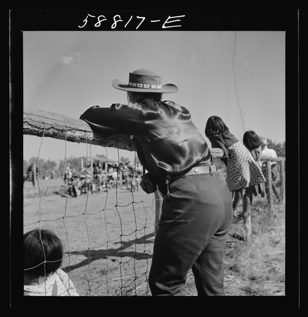 Dude watching the Indian dance at annual fair. Crow Agency, Montana