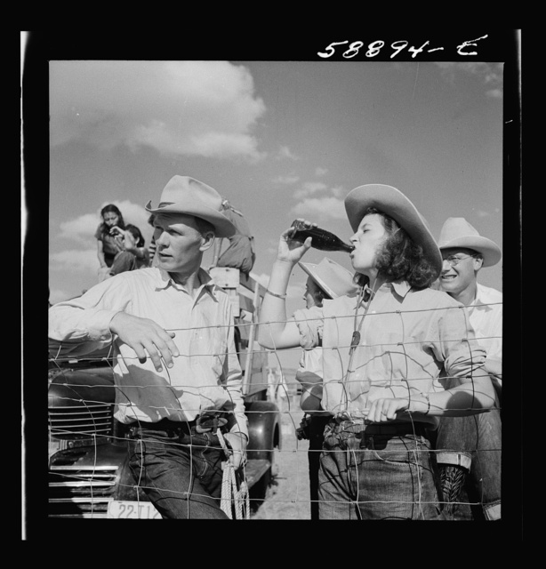 Dudes and cowboy from Quarter Circle U Ranch at Crow Indian fair. Crow Agency, Montana