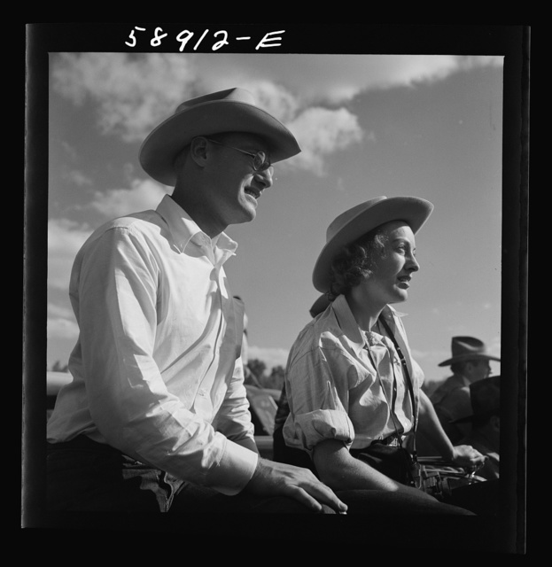 Dudes from Quarter Circle U Ranch watching the rodeo at the Crow Indian fair. Crow Agency, Montana