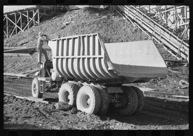 Dump truck which carries materials for use in construction of Shasta Dam, Shasta County, California. This truck uses butane instead of gasoline because of the extra power butane gives