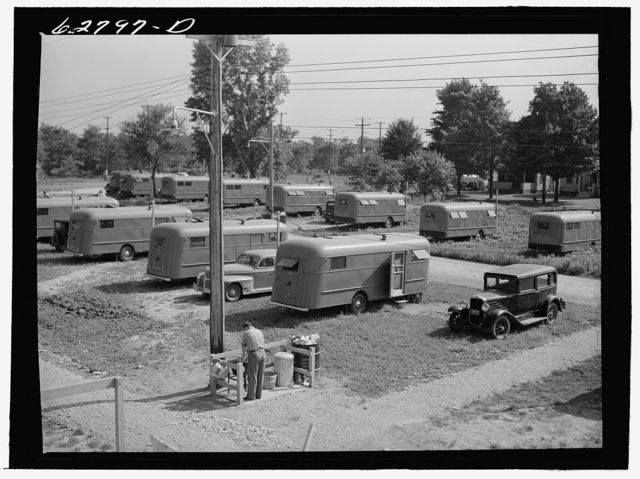 "Each group of ten trailers in the FSA (Farm Security Administration) camp at Erie has a ""trailer service unit,"" water faucet, slop sink, and garbage pail"