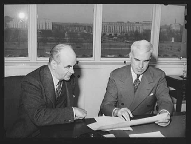 Edward R Stettinius, Jr., former director, Priorities Division, Office of Production Management (OPM), and currently (September 2, 1941) lend-lease Administrator. Dr. Ernest M. Hopkins, Minerals and Metals Executive of the Priorities Division. President of Dartmouth College
