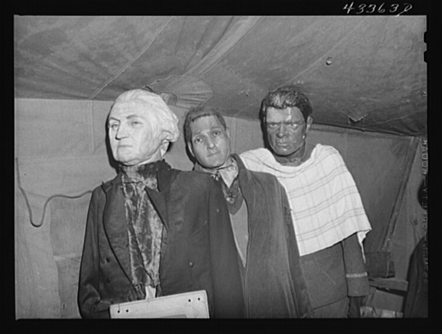"""Effigies of Washington, Joe Louis and some criminal in a travelling sideshow """"crime museum"""". Washington and Joe Louis are examples of """"what you may become if you go straight"""". Near Fort Bragg, North Carolina"""