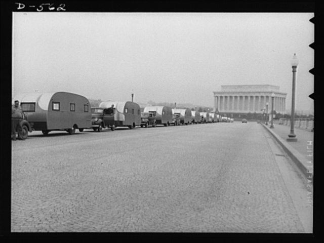 Emergency caravan. To provide temporary housing for defense workers while more permanent quarters are being built for them, this caravan of trailers crosses Memorial Bridge, Washington, D.C., on its way to Wilmington, North Carolina. Trailers are being used all over the U.S. to provide this type of emergency defense housing. This caravan of 50 is the first shipment of more than 2000 currently being constructed