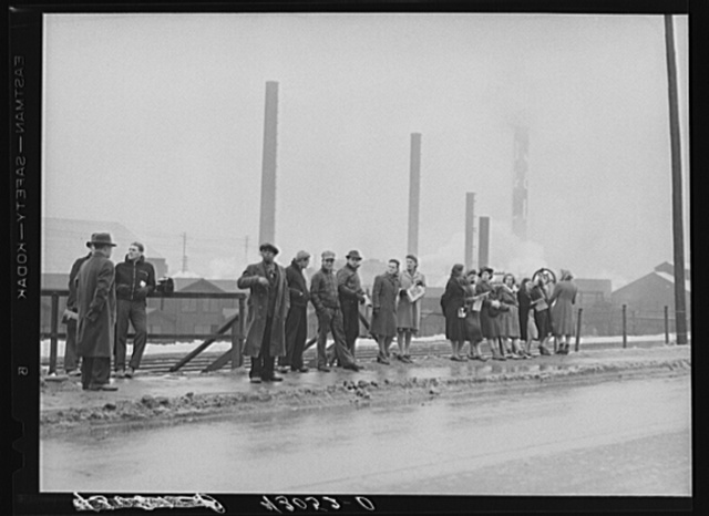 Employees of the Jones and Laughlin Steel Corporation waiting for a bus to go home at 4 o'clock. Aliquippa, Pennsylvania