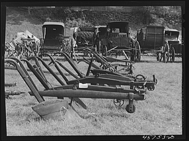 Exhibit of old ploughs and antique buggies at the World's Fair at Tunbridge, Vermont