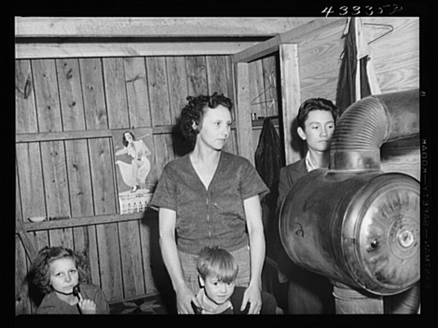 """Family living in the """"downstairs"""" part of a tobacco barn. Father works at Fort Bragg. Near Fayetteville, North Carolina"""
