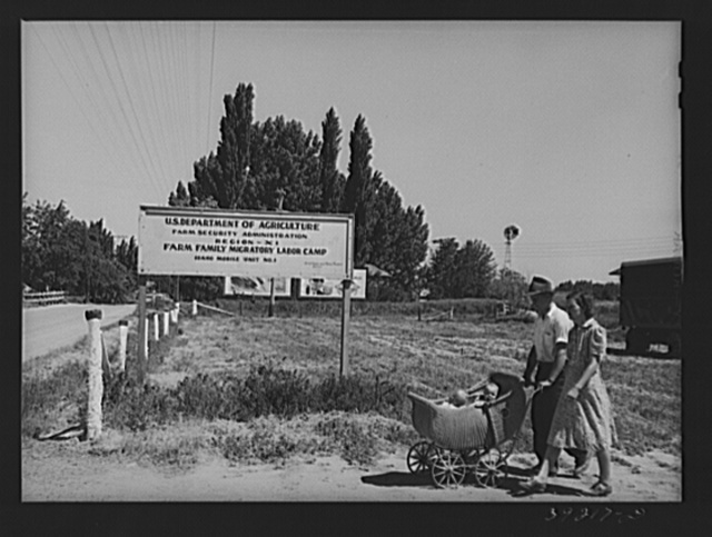 Farm worker and his wife with their twin babies start for a walk into the nearby town. FSA (Farm Security Administration) migratory labor camp mobile unit. Wilder, Idaho