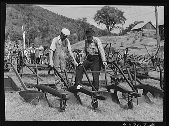 Farmers at the exhibit of old ploughs and farm implements at the World's Fair in Tunbridge, Vermont