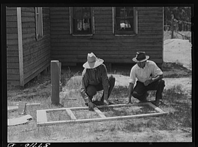 Fastening the stock with corrugated staples. Screen door construction. Charles County, La Plata, Maryland