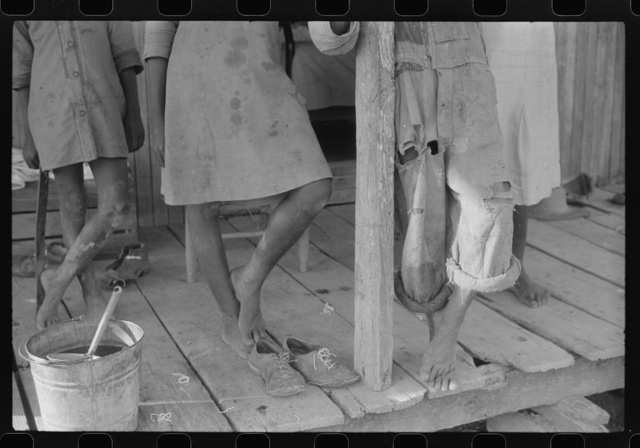 Feet of Negro children on a farm near Greensboro, Alabama