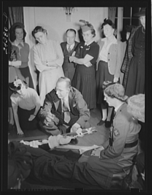 First aid class, American Red Cross, New York City. Demonstrating splint on fractured arm