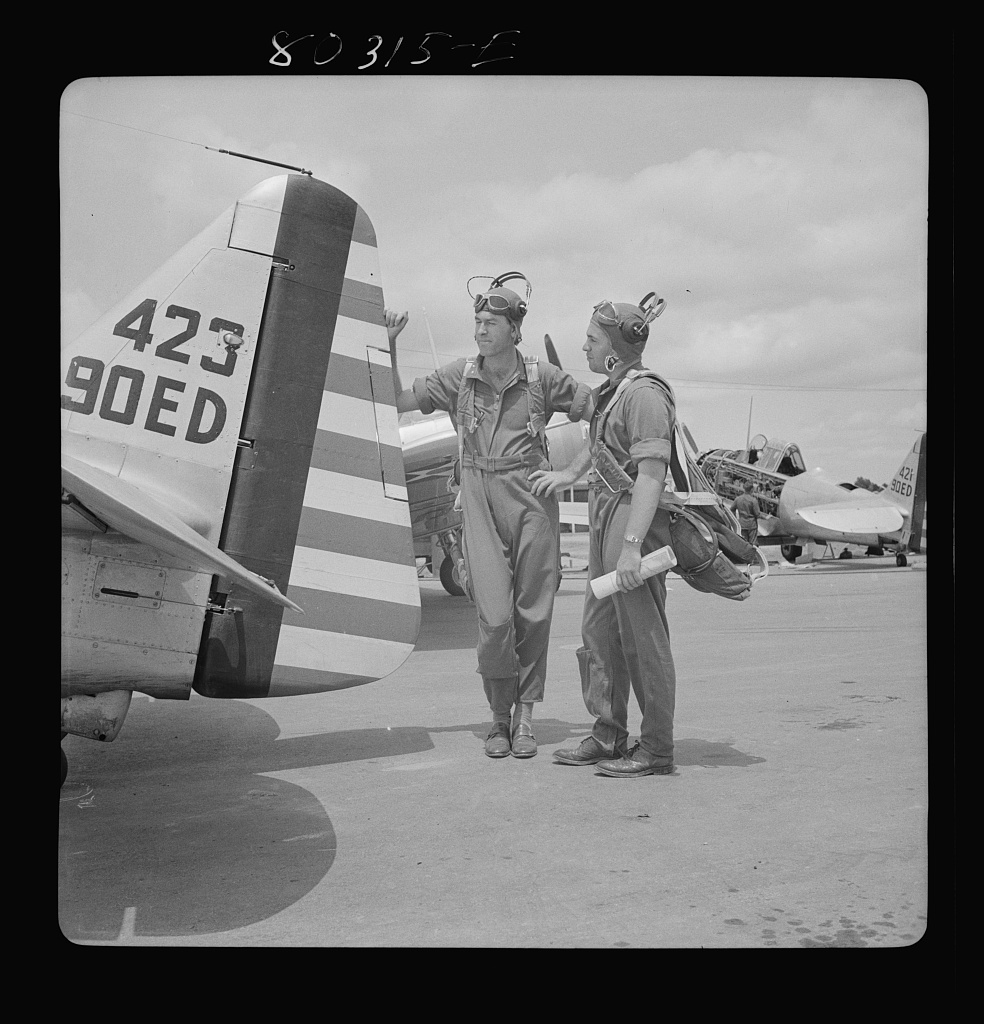 "Flight instructors E.E. McTaggart and J.C. Gumison ""talk things over"" before the take-off. Craig Field, Southeastern Air Training Center, Selma, Alabama"