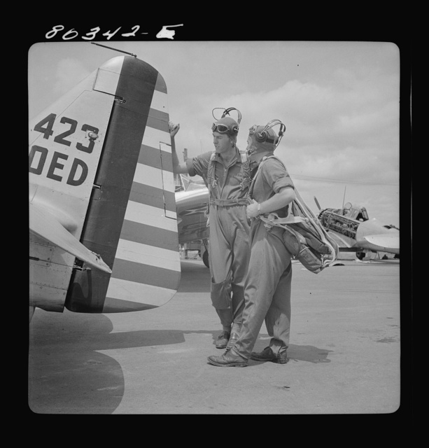 Flight instructors McTaggart and Gumison talk things over. Craig Field, Southeastern Air Training Center, Selma, Alabama