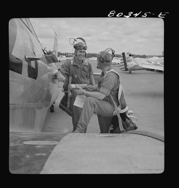 Flight instructors McTaggart and Gumison talk things over. Craig Field, Southeastern Air Force Training Center, Alabama