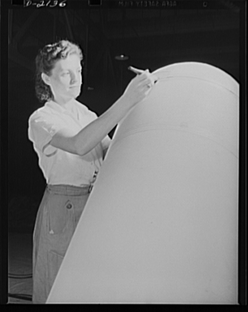 Flotation bag manufacture. Balloon room worker applies cement to airplane flotation bag in balloon room. This bag, easily inflated in a hurry, will help support planes forced down at sea. Goodyear, Akron, Ohio