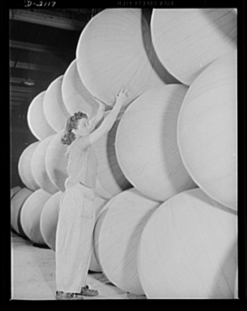 Flotation bag manufacturing. Stack of flotation bags made of rubberized fabric inflated for test purposes, preparatory to deflation for insertion in wings of military airplanes. These bags are used to support planes forced down at sea. Goodyear, Akron, Ohio