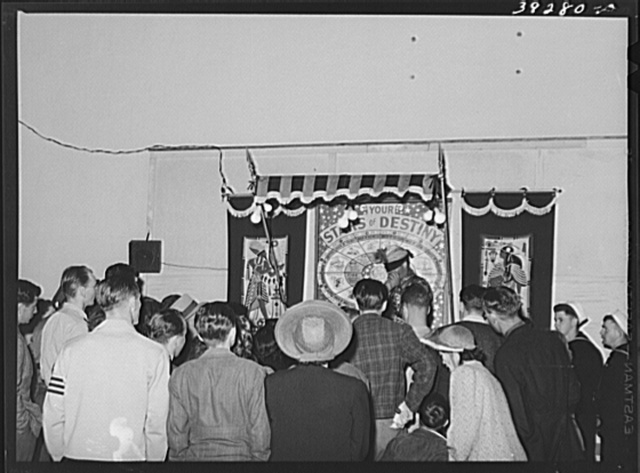 Fortune teller and crowd at Mission Beach, amusement center, San Diego, California
