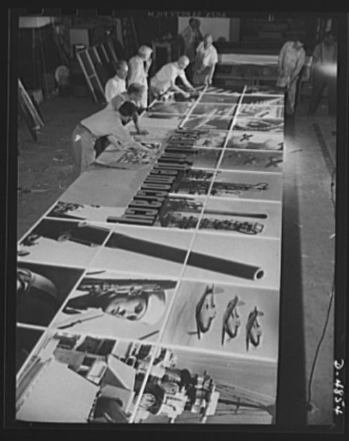 Four Freedoms and Arsenal of Democracy posters. The Arsenal of Democracy panel at the National and Civilian Defense Exposition is readied by workmen. Only half the panel is shown here. This and a montage representing the Four Freedoms were designed by Jean Carlu, eminent psoter artist. Each measures 15 x 30 feet and is divided into 2 1/2 foot squares. These panels display a novel new montage technique used only once before. Displayed under the aegis of the Office of Emergency Management (OEM), theyl will be shortly seen at exhibitions in a number of cities from coast to coast